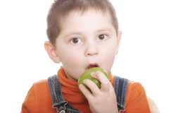 Surprized boy with green apple Stock Photo