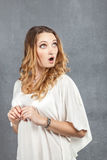 Surprized girl with mouth opened in amazement. Portrait of surprised beautiful girl holding her head in amazement and open-mouthed Royalty Free Stock Photos