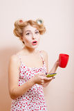 Surprized sexi pinup lady in curlers with cup and Stock Photography