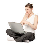 Surprized woman sitting with laptop Stock Photos
