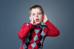 Surpsied listening boy Stock Image