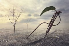 Surreal artistic illustration with a leaf on gravel and rusty metal Royalty Free Stock Photo