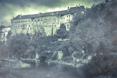 Surreal atmosphere at the Cesky Krumlov castle with fog on autumnal day Stock Photography