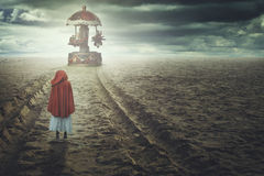 Surreal beach with toy carousel Royalty Free Stock Photography