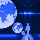 Surreal blue metallic interior room with figure of young man and world globe. Elements of this image furnished by NASA. Royalty Free Stock Photo