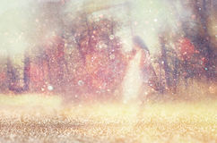 Surreal blurred background of young woman stands in forest. abstract and dreamy concept. image is textured and retro toned stock photography