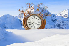 Surreal broken clock on the snow Stock Photos