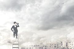 Free Surreal Businessman Observe With The Telescope From The Top Of The City Stock Images - 124843784