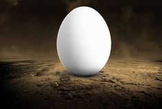Surreal Chicken Egg, Desolate Desert. Surreal chicken egg in a desolate desert. The unusual and different background provides unique surrealism royalty free stock photo