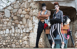 Surreal Circus Performers. Pair of comedia del arte performers in hat and striped pants Royalty Free Stock Images
