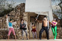 Surreal Cirque Stage Combat. Comedia del arte ensemble in stage combat outdoors Stock Images