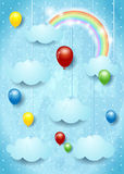 Surreal cloudscape with colorful balloons Royalty Free Stock Image