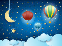 Surreal cloudscape with hanging moon and balloons Stock Images