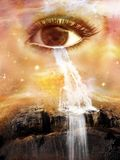Surreal Cosmic Eye, Waterfall, Tears, Cry, Water. Surreal cosmic eye in the heavens above an alien planet. Tears flow like a waterfall in this surrealism nature Royalty Free Stock Photography