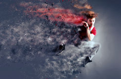 Surreal dancer decomposing in particles. Surreal dancer exploding and decomposing in particles during dance action royalty free stock photo