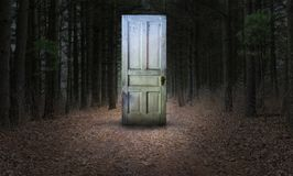 Surreal Door, Woods, Path, Forest. Surreal abstract concept of an old door in the path or pathways of a dark woods or forest. What reality and challenges await stock image