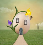 Surreal egg house. Egg house with daffodil flower Stock Photography