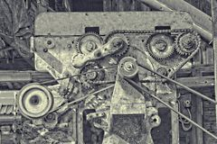 Surreal engine with v-belt and cogwheel Royalty Free Stock Images