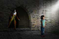 Surreal Evil Halloween Clown, Stalker, Young Girl royalty free stock photo