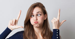 Surreal expression with funny woman with huge eyes for LOL. Concept of surreal expression with funny young woman with huge exaggerated eyes for a boring pouting Royalty Free Stock Photography