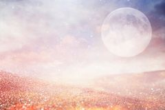 Surreal fantasy concept - full moon with stars glitter over planet. Royalty Free Stock Image