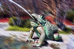 Surreal Frog. Surreal spitting green frog in park Stock Photo