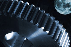 Surreal gear-wheel against a full moon stock image