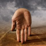 Surreal hand. Surreal male hand on landscape Stock Photography