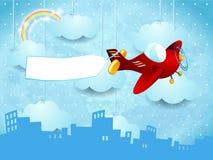 Surreal horizon met het hangen van wolken, vliegtuig en banner Stock Foto's