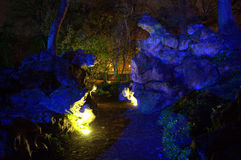 Surreal illuminated  rockery in the park Stock Photos