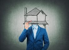 Surreal image as a businessman architect with invisible face holding a pencil in his hand draw house sketch instead of head. Home. Of dreams, property insurance stock image