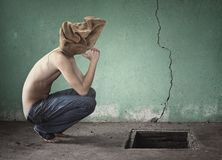 Surreal image with bag over his head shirtless and blue jeans Royalty Free Stock Photography