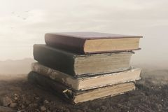 Surreal image of giant books on top of each other touching the sky stock photos