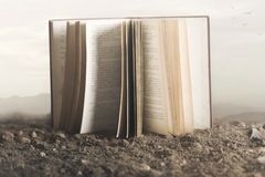 Surreal image of a giant open book in the middle of the nature stock images