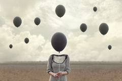 Surreal image of woman and blacks balloons flying. In the sky stock photos