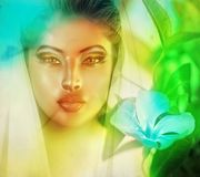 Surreal image of womans face. On an abstract background in a tropical, quixotic setting. A blue flower and soft lighting enhances the dream state feel of this Stock Images