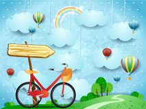 Surreal landscape with hanging clouds, arrow sign and bike Royalty Free Stock Photos