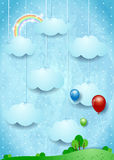 Surreal landscape with hanging clouds and balloons Royalty Free Stock Photo
