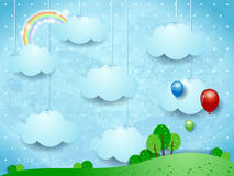 Surreal landscape with hanging clouds and balloons Stock Photography
