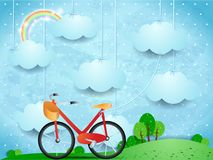 Surreal landscape with hanging clouds and bike Stock Photos