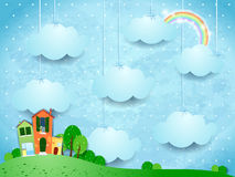 Surreal landscape with hanging clouds and homes Royalty Free Stock Photo