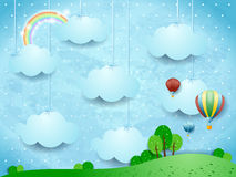 Surreal landscape with hanging clouds and hot air balloons Stock Image