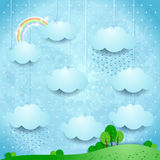 Surreal landscape with hanging clouds and rain Royalty Free Stock Images