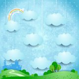 Surreal landscape with hanging clouds and small city Stock Images