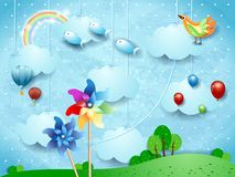 Surreal landscape with hanging pinwheels, balloons, birds and flying fishes. Vector illustration eps10 vector illustration
