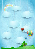Surreal landscape with hot air balloons and hanging clouds Royalty Free Stock Photo