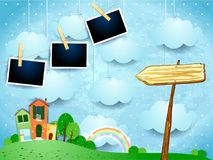 Surreal landscape with little town, arrow sign and photo frames. Vector illustration eps10 royalty free illustration