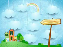 Surreal landscape with little town and arrow sign Stock Image