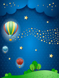 Surreal landscape by night with balloons and wave of stars Stock Photography