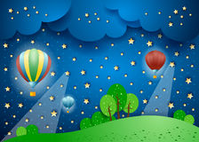 Surreal landscape by night with hot air balloons Royalty Free Stock Photo